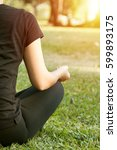yoga outdoors in warm autumn... | Shutterstock . vector #599893175
