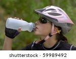 Young Woman Riding Mountain...