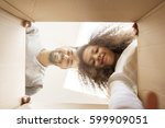 man and a girl looking into a... | Shutterstock . vector #599909051