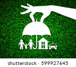 Small photo of paper salesman agent hand holding family protection on green leaves background. concept accident prevention healthcare insurance.