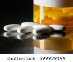 macro of white tablets on metal ... | Shutterstock . vector #599929199