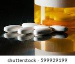 macro of white tablets on metal ... | Shutterstock . vector #599929199