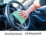 hand cleaning the car interior... | Shutterstock . vector #599964449