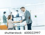 handshake between lawyer and... | Shutterstock . vector #600022997