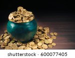 gold coins in a green pot on a... | Shutterstock . vector #600077405