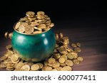 gold coins in a green pot on a... | Shutterstock . vector #600077411