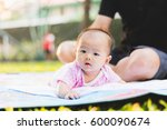 father parenting baby on park | Shutterstock . vector #600090674