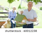 smiling senior man with his... | Shutterstock . vector #60012238