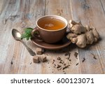 brown cup of ginger tea with... | Shutterstock . vector #600123071