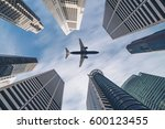 Aircraft Traveling Over City...