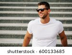 Handsome man smiling with perfect teeth. Dental care