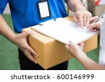 woman accepting a delivery of... | Shutterstock . vector #600146999