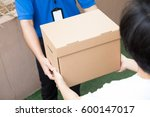 woman accepting a delivery of... | Shutterstock . vector #600147017