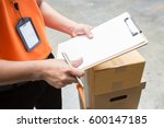 delivery man with box and... | Shutterstock . vector #600147185