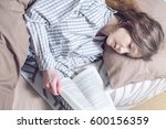 cute girl reading with interest ... | Shutterstock . vector #600156359