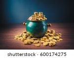 gold coins in a green pot on a... | Shutterstock . vector #600174275