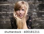 stunning blond woman with blue... | Shutterstock . vector #600181211