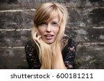 stunning blond woman with blue... | Shutterstock . vector #600181211