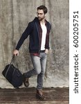 Small photo of Dude with a holdall bag in studio