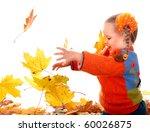 Little girl in autumn orange leaves. Isolated. - stock photo