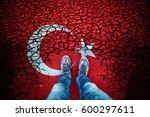 man standing on cracked damaged ... | Shutterstock . vector #600297611