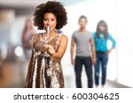 young black woman holding a... | Shutterstock . vector #600304625