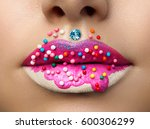 close up view of female lips... | Shutterstock . vector #600306299