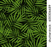 tropical palm leaves seamless... | Shutterstock .eps vector #600306689