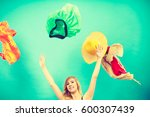 Small photo of Cleaning in the closet, fashion, happiness concept. Woman throwing up lot of clothes. Clothing flying all over the place