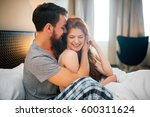 happy couple in bedroom... | Shutterstock . vector #600311624
