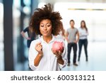 Young Black Woman Holding A...