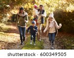 family running along path... | Shutterstock . vector #600349505