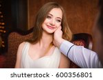 a man gently touches a woman. | Shutterstock . vector #600356801