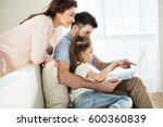side view of parents and... | Shutterstock . vector #600360839