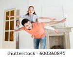 smiling mother watching how... | Shutterstock . vector #600360845