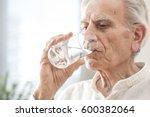 portrait elderly man drinking... | Shutterstock . vector #600382064