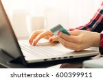 woman making online payment... | Shutterstock . vector #600399911