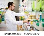 smiling male pharmacist...   Shutterstock . vector #600419879