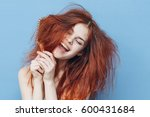 funny woman with disheveled hair | Shutterstock . vector #600431684