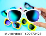 hand holding sunglasses with... | Shutterstock . vector #600473429