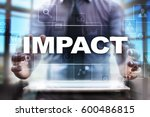 Small photo of Businessman using tablet pc and selecting impact.