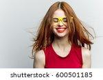 funny pretty woman smiles into...   Shutterstock . vector #600501185