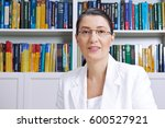 mature woman in white blazer in ... | Shutterstock . vector #600527921