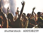rear view of crowd with arms... | Shutterstock . vector #600538259