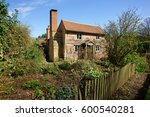 A Quaint English Cottage In...