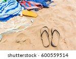 beach sands towels slippers ... | Shutterstock . vector #600559514