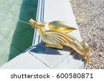 a gilded water spitting dragon... | Shutterstock . vector #600580871