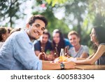 group of young people having... | Shutterstock . vector #600583304