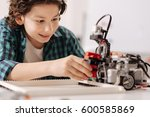 capable teen kid constructing... | Shutterstock . vector #600585869