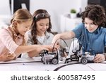 cheerful kids working on the... | Shutterstock . vector #600587495